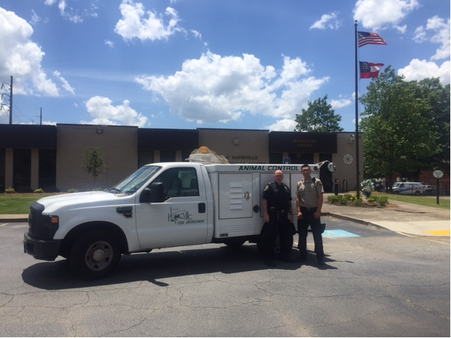 Lieutenant William Hughes and Code Enforcement Officer Zarate with the Animal Control Truck