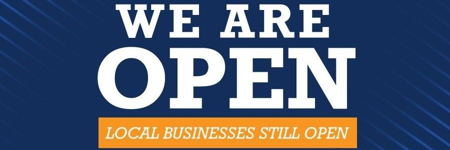 "Banner that says ""We Are Open for Business"""